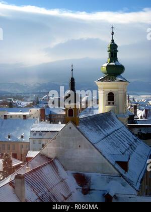 Snowy rooftops of Sibiu, Romania - Stock Photo