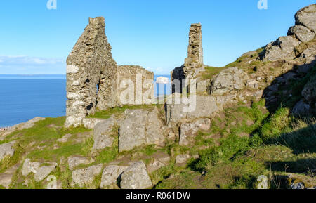 View from top of North Berwick Law, on sunny day, view ruins out to Bass Rock and the Firth of Forth, through North Berwick, East Lothian, Scotland - Stock Photo