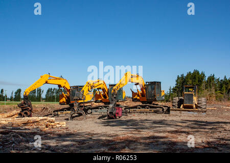 Machinery used in the forestry industry parked up at a logging site in New Zealand - Stock Photo