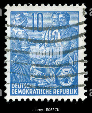 Postmarked stamp from the East Germany in the Five-year Plan series - Stock Photo