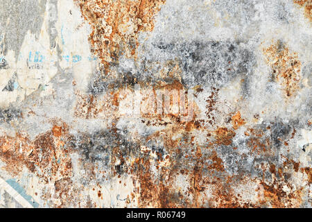 corroded sheet metal background with remains of posters - Stock Photo