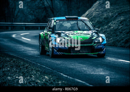 A rally car going through on of the stages in Lower Silesia Austria. - Stock Photo