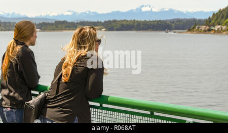 EN ROUTE SEATTLE TO BREMERTON - JUNE 2018: Two people looking out at the scenery from a passenger ferry from Seattle to Bremerton. - Stock Photo