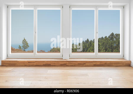 inside modern apartment with with wooden floor, terrace windows and panoramic landscape view - Stock Photo