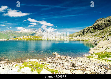 Turquoise crystalline water of lake Bergsee, Spluga Pass, canton of Graubunden, Switzerland, Europe - Stock Photo