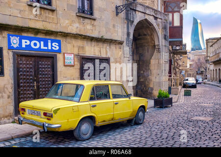 Old yellow soviet car (Moskvitch) in Icheri Sheher (Old City), Baku, Azerbaijan - Stock Photo