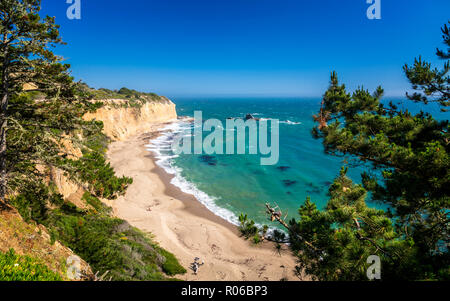 View of beach and cliffs on Highway 1 near Davenport, California, United States of America, North America - Stock Photo