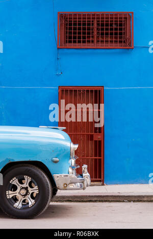 Front of old vintage car parked in front of blue building, Havana, Cuba, West Indies, Caribbean, Central America - Stock Photo