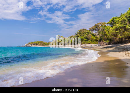 A view of a beach and the Caribbean sea in Tayrona National Park in Colombia, South America - Stock Photo