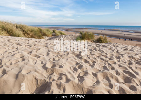 Camber Sands, sandy beach at the village of Camber, East Sussex near Rye, England, the only sand dune system in East Sussex. View of the dunes, grass - Stock Photo