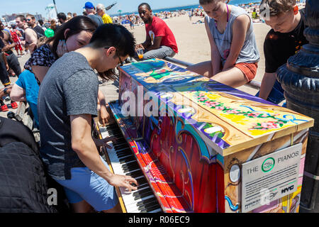People having fun watching the Annual Mermaid Parade at Coney Island, Brooklyn, New York. - Stock Photo