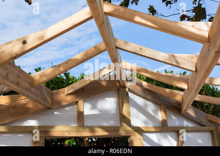 Building summer house or shed in the garden, wooden structure, waterproofed, close up of the roof, selective focus - Stock Photo