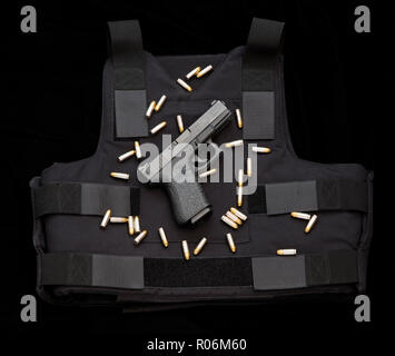 Glock semiautomatic pistol and bulletproof vest. - Stock Photo
