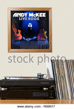 Record player and framed album cover Andy McKee album Live Book, England - Stock Photo