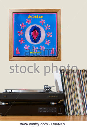Record player and framed album cover Dubstar 1995 debut album Disgraceful, England - Stock Photo