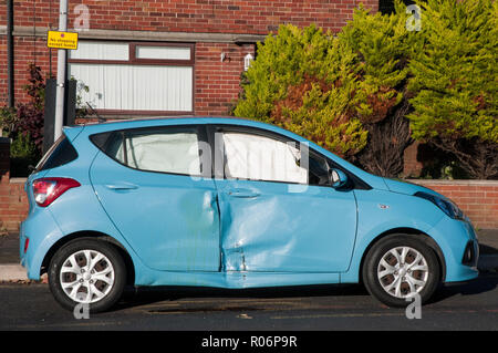 Damage to side of car and air bags deployed after Road traffic accident RTA with motorbike - Stock Photo
