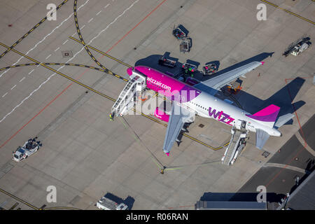 Aerial view, WIZZ-Air, travel jet at the loading position, luggage cart, Dortmund International Airport, DTM, overview of runway 06 and apron, apron,