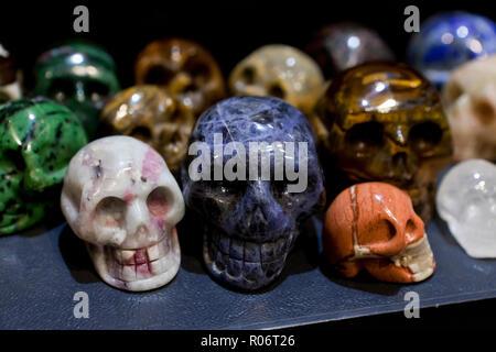 Skull carvings of semi precious stones - USA - Stock Photo