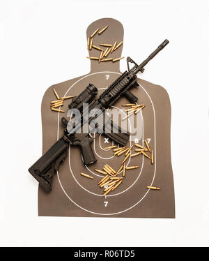 AR-15 assault rifle on target with live ammunition - Stock Photo