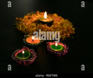 Colourful diya arranged in diffrent ways to celebrate Diwali and Dhanteras - Stock Photo