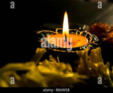 Isolated diya/lamp placed on table - Stock Photo