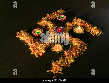 A top view of Diya kept on flowers - Stock Photo