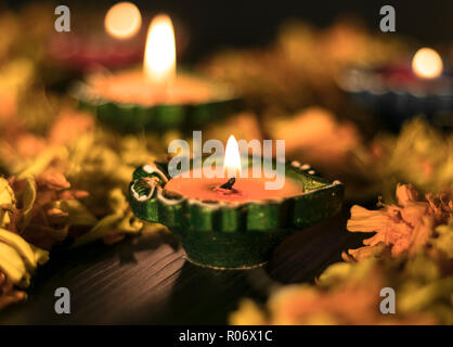 Colourful diyas arranged in diffrent ways - Stock Photo