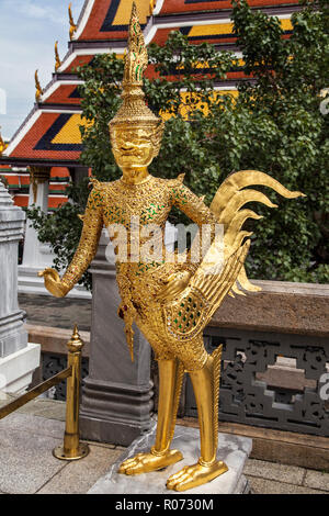 Statue of an Asurapaksi, a mythical creature with the head of a giant and the lower body of a bird, in Wat Phra Kaew, Bangkok, Thailand. - Stock Photo