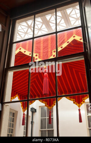 View through window to awning in courtyard - Stock Photo