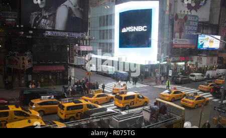 Taxis line the streets of Times Square on a busy day in New York City. - Stock Photo