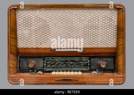 VINTAGE RUSSIAN TUBE RADIO. Old Russian tube tabletop radio in wooden case, on isolated gray background with clipping path. - Stock Photo