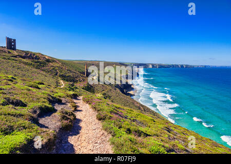 The South West Coast Path as it passes the abandoned Wheal Coates Cornish Tin Mine, North Cornwall, UK, on a beautiful summer day. - Stock Photo