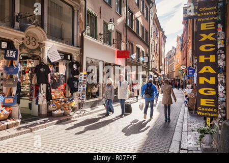 16 September 2018: Stockholm, Sweden - Tourists wandering the streets of Gamla stan, Stockholm's old town, on a sunny autumn day. - Stock Photo