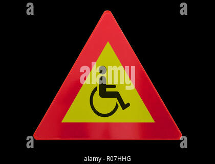 Traffic sign isolated - Man in wheelchair - On black - Stock Photo