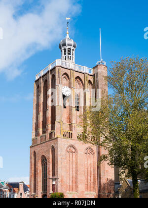 Tower of Great Saint Gertrudes Church in city centre of historic town of Workum, Friesland, Netherlands - Stock Photo