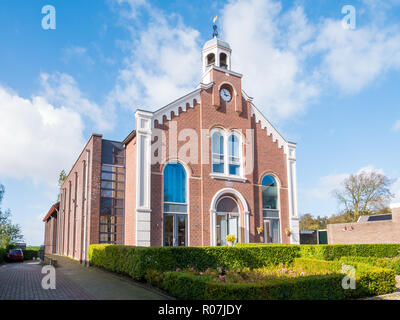 Former church building now apartment building in downtown Workum, Friesland, Netherlands - Stock Photo