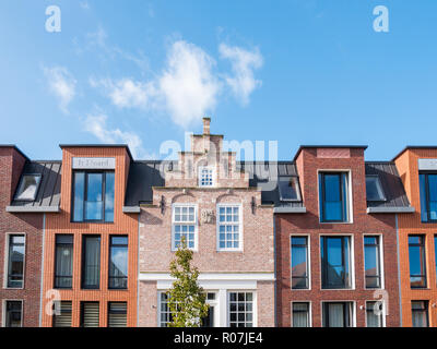 Top facades of old and new houses in city centre of Workum, Friesland, Netherlands - Stock Photo