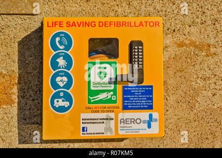 LIFE SAVING DEFIBRILLATOR ON A WALL KEIRANS LEGACY - Stock Photo