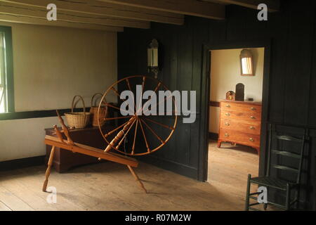 Spinning wheel at Frontier Culture Museum in Staunton, Virginia - Stock Photo