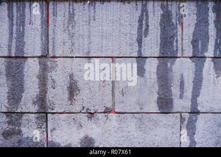 Part of gray grunge concrete wall with vertical flowing wet smudges. - Stock Photo