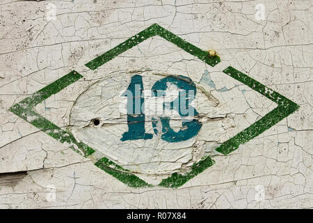 Number thirteen. Sign, put paint on the old wooden painted surface - Stock Photo