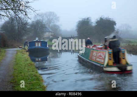 Traditional narrowboat approaching lock on the Grand Union Canal heading north early morning at Hunton Bridge, near Leavesden, Hertfordshire, England - Stock Photo