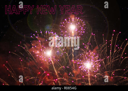 Fireworks on the black sky. Festive show. Large-scale celebration. The explosion of a million lights in the sky. Text Happy New Year on firework backg - Stock Photo