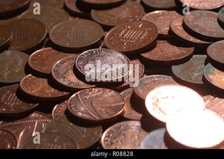 A heap of one pence coins - Stock Photo
