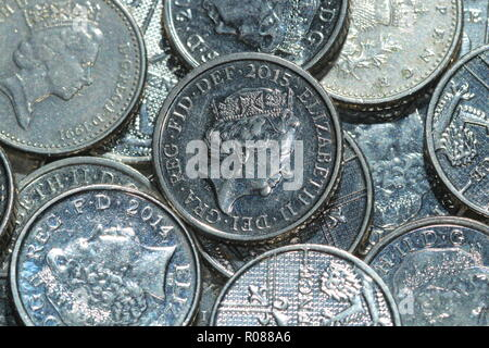 A pile of 5 pence coins, which are Britain's smallest silver coins which have been in circulation since 1990