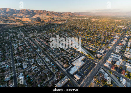 Late afternoon aerial towards Devonshire St and Canoga Ave in the Chatsworth neighborhood of the San Fernando Valley area in Los Angeles, California. - Stock Photo