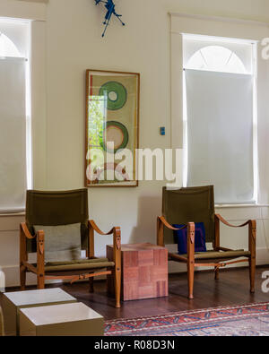 Matching armchairs by painting - Stock Photo