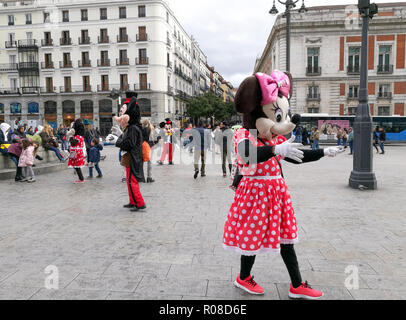 Madrid, Spain. April 30, 2017 : People in costumes of Minnie and Mickey Mouse are walking to entertain tourists on the street of Plaza Puerta del Sol. - Stock Photo