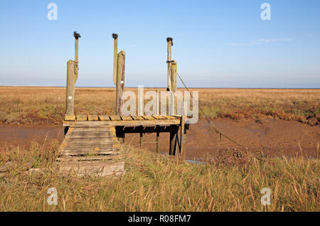 A landing stage on the quayside in the North Norfolk harbour at Thornham, Norfolk, England, United Kingdom, Europe. - Stock Photo