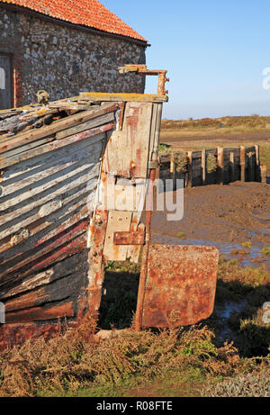 The rudder on an abandoned clinker built boat on the North Norfolk coast at Thornham, Norfolk, England, United Kingdom, Europe. - Stock Photo